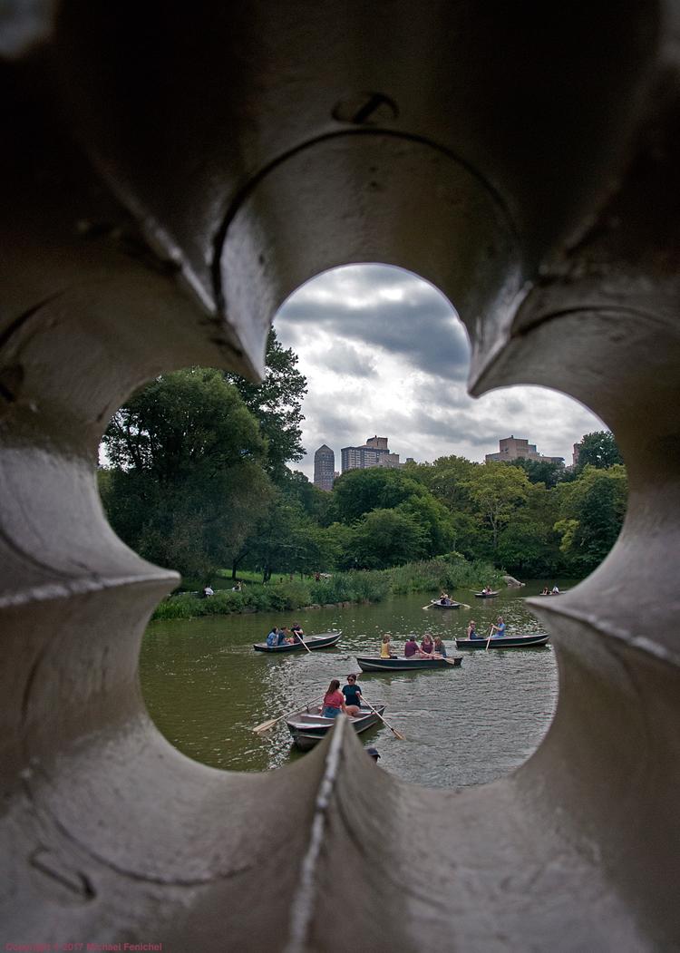 [View of Central Park pond through Bow Bridge]