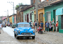 Blue Car on Cobblestone