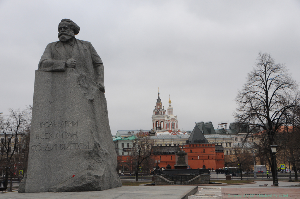 [Karl Marx and Revolution Square - Day]
