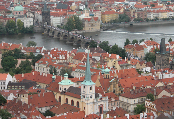 [Charles Bridge (Karlův most) - View from St. Vitus Belltower. Click on the photo to fly in closer, to the tower on the right on this end of the bridge, with a lovely view of Charles Bridge and Mala Strana.]