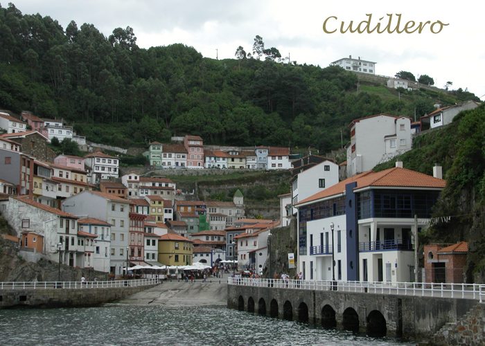 Cudillero, arriving from the sea. - Click here to see the vertical houses on cliffs.